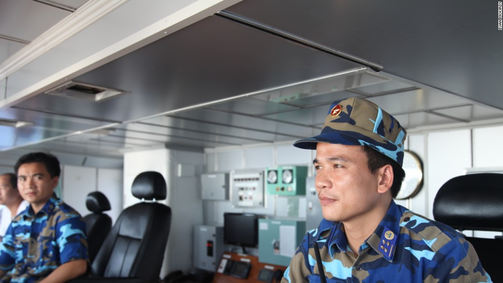 Captain Nguyen Van Hung mans the bridge.