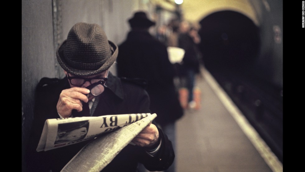 "In this image, also from the mid '80s, a man reads the newspaper with two pairs of glasses. ""Lots of people think it's a magnifying glass,"" Mazzer writes in his book, Bob Mazzer Underground. ""But it is another pair of spectacles."""