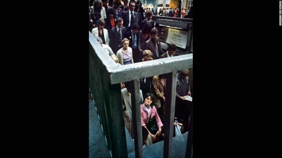 "This image was taken outside the Oxford Circus tube station, in central London. Mazzer recalls thinking ""thank you"" for this woman, in her pink coat, for suddenly poking her tongue out as people poured ""like ants"" down into the underground."