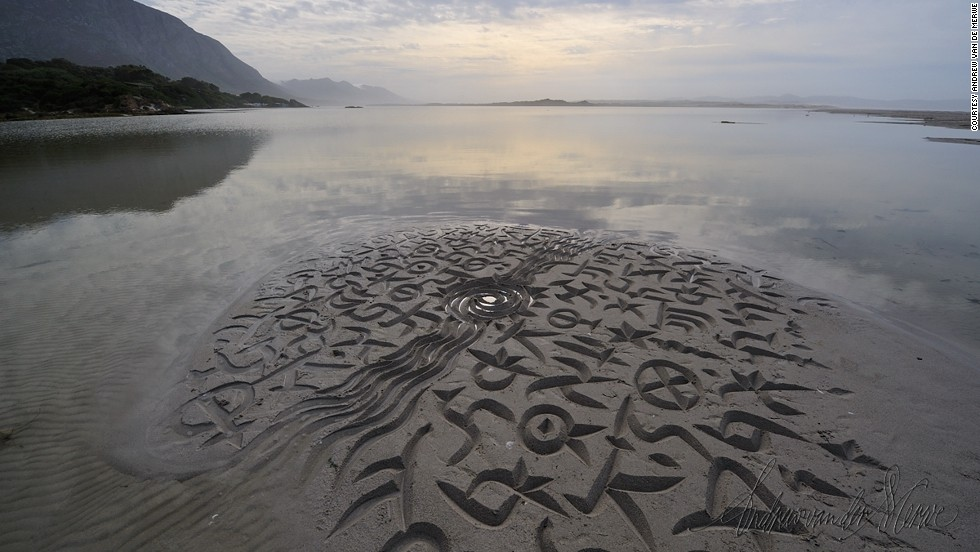 "The natural environment is an important theme for the calligrapher. He often enjoys playing with the relationship between the sun and water, as pictured here at the Kleinrivier river mouth -- meaning ""Small river"" in Afrikaans --  in Hermanus, near Cape Town. <br /><br />Van der Merwe says the asemic nature of his work means that he can take the African writing influences he has become so passionate about and combine them with traditions present from the West's writing systems. He adds: ""I play with it, I break it, join it, adapt it, which is entertaining to me, it's a nice challenge. It's like playing with a musical theme. If you look at asemic writing on the beach, there's a musicality to it -- there is a rhythm and a logic.<br /><br />""Sometimes what I do is I borrow from those forms and adapt western writing letter forms. It's a hybrid of the two, like what Paul Simon did with Ladysmith Black Mambazo, borrowing from African music."""