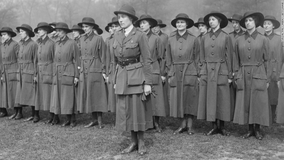 Female army recruits from the United Kingdom are seen during drills in May 1917. World War I broke down barriers between military and civilian life. With the men away in battle, women took on an extraordinary role in support of the war, whether it was on the front lines or at home in factories and farms.