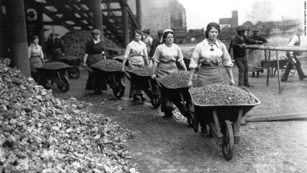 "Women ""navvies"" work on railway building in Coventry, England."