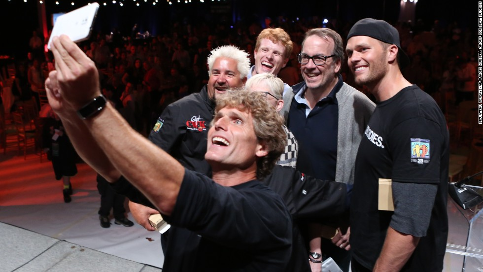 Anthony Shriver, founder and chairman of the nonprofit Best Buddies International, takes a selfie with some famous faces Friday, May 30, during a dinner party in Boston. The four men behind Shriver, from left, are renowned chef and television host Guy Fieri, Congressman Joe Kennedy of Massachusetts, financial services executive John Hailer and New England Patriots quarterback Tom Brady. Best Buddies advocates for people with intellectual and developmental disabilities.