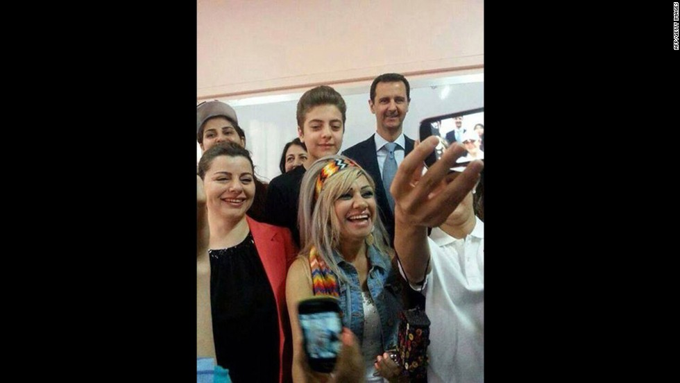 "A handout picture released by the official Facebook page of Syrian first lady Asma al-Assad shows Syrian President Bashar al-Assad, back right, posing for a selfie with voters in Damascus, Syria, on Tuesday, June 3. Al-Assad is expected to win re-election <a href=""http://www.cnn.com/2014/06/03/world/gallery/syria-elections/index.html"">in a vote</a> that opposition groups and many Western countries say has been rigged from the start."