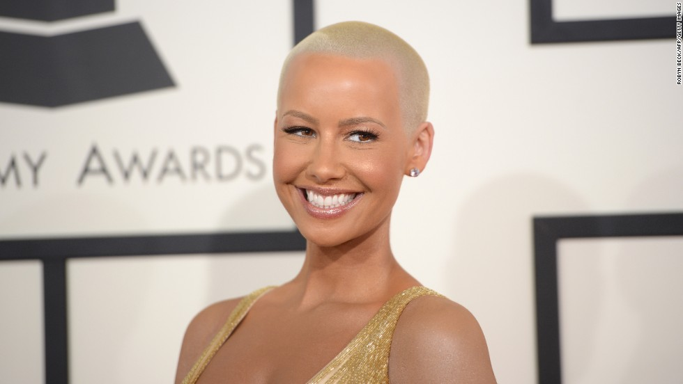 "Amber Rose's bald look has become her signature -- so much so that <a href=""http://omg.yahoo.com/blogs/celeb-news/amber-rose-almost-unrecognizable-very-long-hair-180632250.html"" target=""_blank"">a playful photo of the celebrity model in a long blond wig</a> rendered her nearly unrecognizable. But it turns out her cut is inspired by another short-hair standout: Sinead O'Conner. ""I knew I wanted to look as beautiful as she did one day, so when I was old enough to make my own decisions, at 19, I cut it off,"" Rose told <a href=""http://www.inkedmag.com/features/article/amber-rose/"" target=""_blank"">Inked magazine in 2011</a>."
