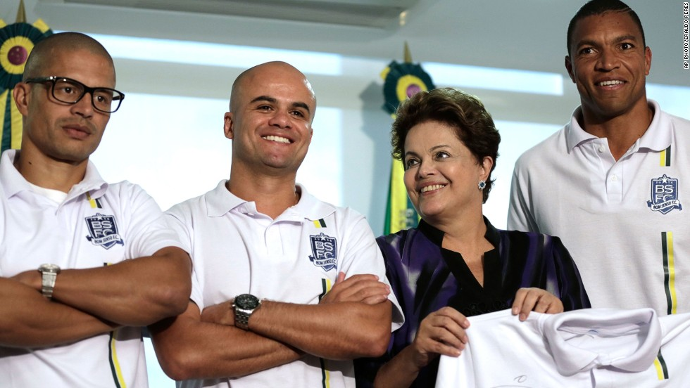 President Rousseff receives a shirt from Bom Senso FC from footballer Dida, right. Also standing next to her are the players Rui, second left, and Alex, left, after a meeting with sportsmen at the Planalto presidential palace, in Brasilia, Brazil on May 26, 2014.  Bom Senso FC, meaning Good Sense Football Club in Portuguese, is a movement created by the players in 2013 to demand change in Brazilian football.