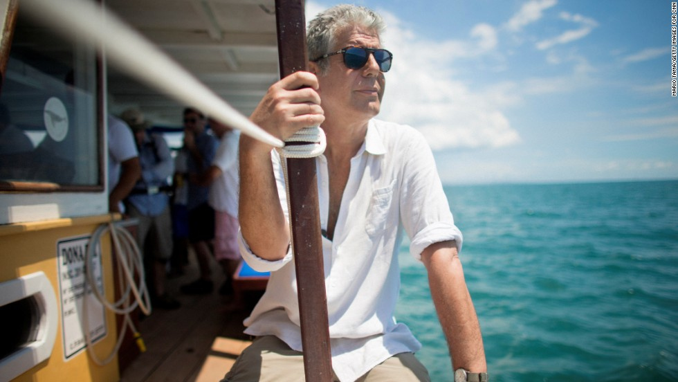 Bourdain takes in the sights while riding a boat in the Atlantic Ocean. Brazil has one of the world's most extensive collections of tropical shores.