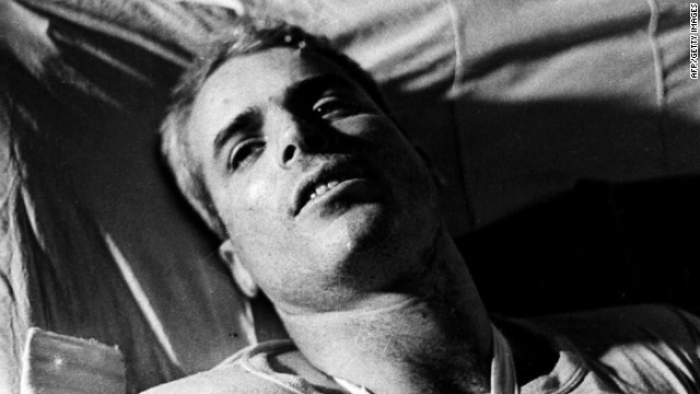 This file picture taken in 1967 shows US Navy Lt. Cmdr. John McCain lying on a bed in a Hanoi hospital as he was being given medical care for his injuries.