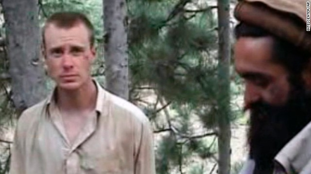 This file image provided by IntelCenter on Wednesday Dec. 8, 2010 shows a frame grab from a video released by the Taliban containing footage of a man believed to be Sgt. Bowe Bergdahl, left.