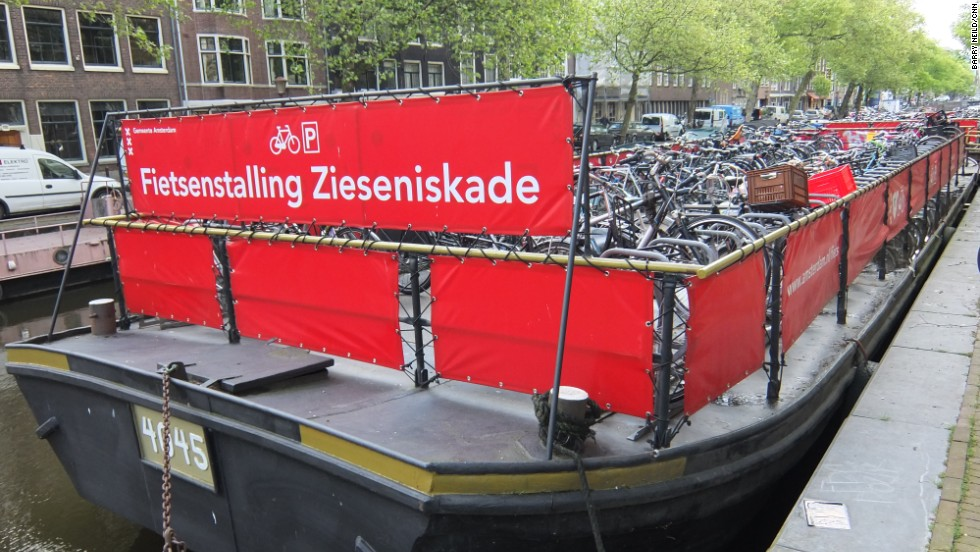 Sometimes bikes end up in a canal on purpose. One ingenious storage solution makes use of the city's waterways to accommodate a floating bike park.