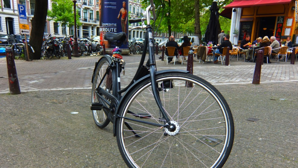 Many big companies rent out bikes in lurid colors. The key to blending in is renting a typical Dutch-style cycle, like this black, indestructible machine.