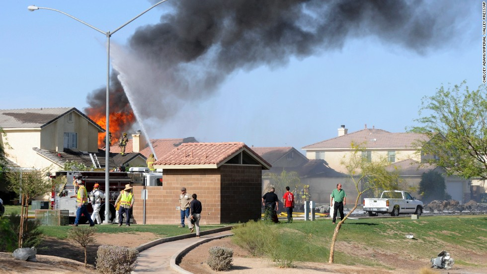 "Flames and smoke rise from a residential area in Imperial, California, where <a href=""http://www.cnn.com/2014/06/04/us/california-military-plane-crash/index.html"">a Marine jet crashed</a> on Wednesday, June 4. The pilot, who was on a training flight, ejected safely and suffered only minor injuries, the Marines said. There were no reports of civilian injuries on the ground, but two homes were destroyed and one was severely damaged."