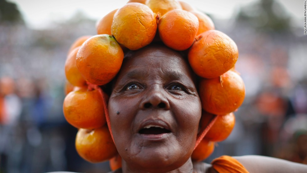 A supporter of Raila Odinga, a former Kenyan prime minister, listens to Odinga speak Saturday, May 31, during a rally in Nairobi, Kenya. Odinga's political party is the Orange Democratic Movement.