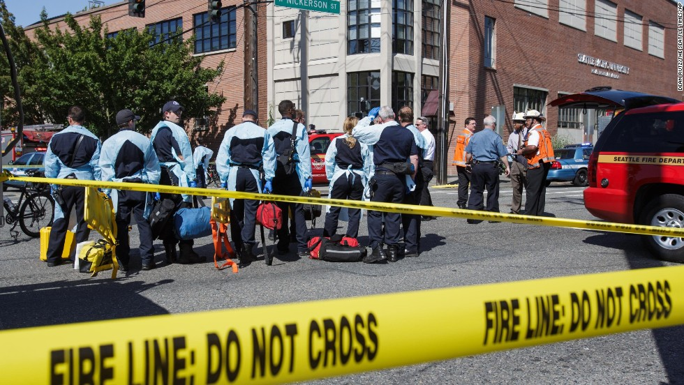 Emergency personnel gather near the scene of the shooting.