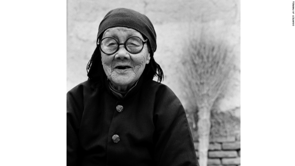 "Portrait of Yang Jinge. The 91-year-old woman told Farrell: ""Bound feet was a disrespect for the body, sometimes it was too painful and I couldn't go away to another village or to school. Bound feet is blind faith -- it was believed it would help us have a better marriage but when I had my feet bound it was already such an old tradition and was not a part of modern China."""