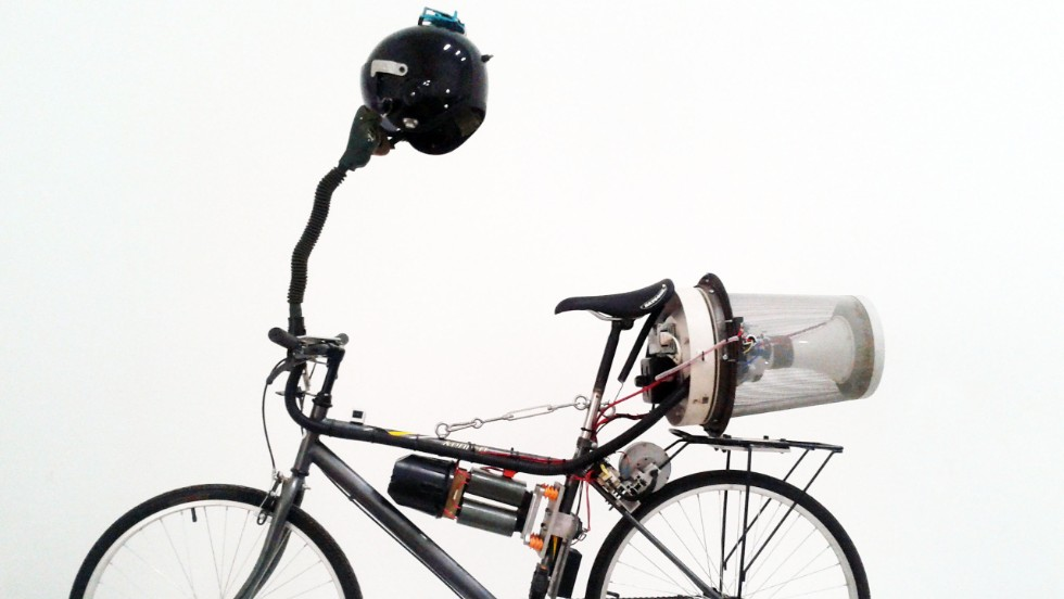 "British artist Matt Hope attached a small generator to a bike's back wheel and as he pedals, electricity is produced to power his homemade filtration system. He says it's ""an ironic commentary about living in China."""