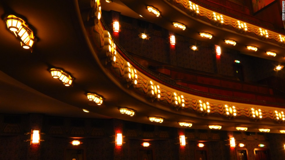 The theater was restored to its former glory in an expensive refurbishment in the 1980s. Lamps on the underside of the balconies seem to resemble caterpillars.