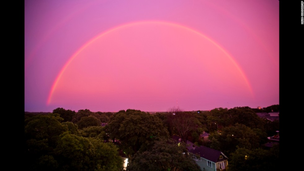 "The sky over Atlanta turns pink as a rainbow appears at dusk after a thunderstorm Thursday, June 5. <a href=""http://www.cnn.com/2014/05/30/world/gallery/week-in-photos-0530/index.html"">See last week in 35 photos</a>"