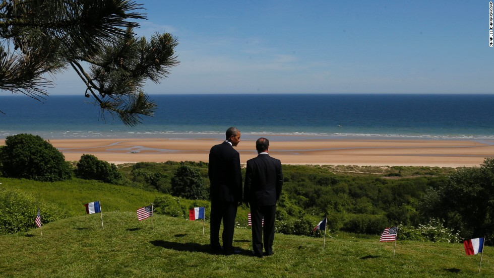 President Obama and French President Francois Hollande survey Omaha Beach on June 6.