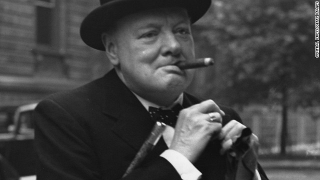 Caption:5th June 1941: Winston Churchill (1874 - 1965) pins his flag into his lapel after he had bought one in aid of Red Cross Day in London. (Photo by Central Press/Getty Images)