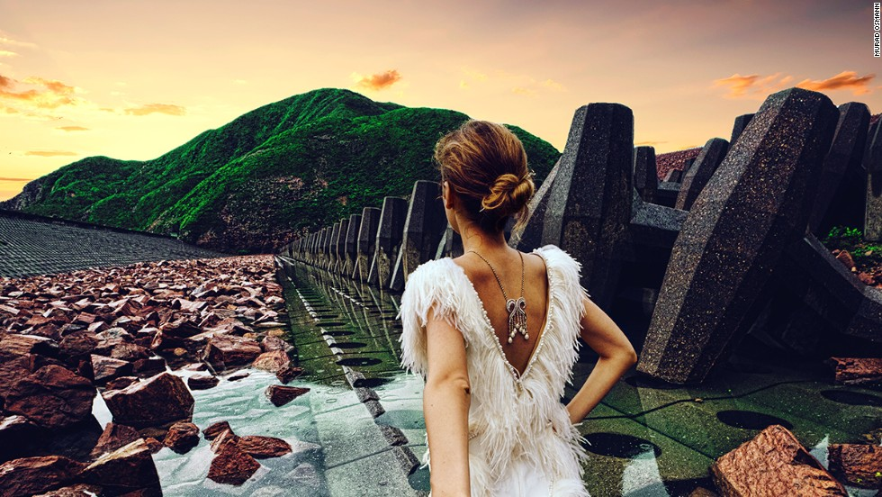 "The ""Follow Me To"" photography project that made social media waves last year has been commissioned for a tourism campaign in Hong Kong. Here, Natalia Zakharova leads her photographer boyfriend Murad Osmann through the city's Global Geopark."