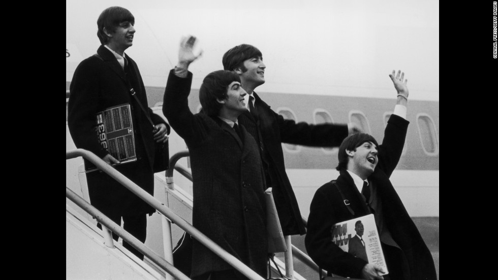 The Beatles exploded on the American scene, kicking off the British Invasion. Ringo Starr, George Harrison, John Lennon and Paul McCartney arrive at JFK airport to an overwhelming, screaming reception to start their U.S. tour in 1964.