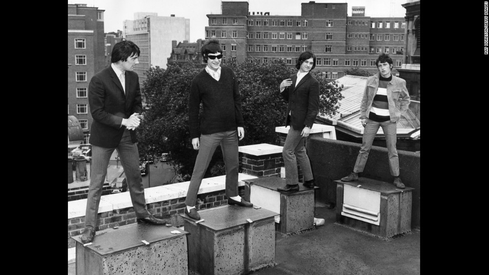 "Ray Davies, Dave Davies and Pete Quaife of The Kinks stand on a London rooftop. They brought a satiric and intelligent take to pop music. The band hit the U.S. with ""Waterloo Sunset,"" ""Tired of Waiting for You"" and ""Lola,"" among many other songs."