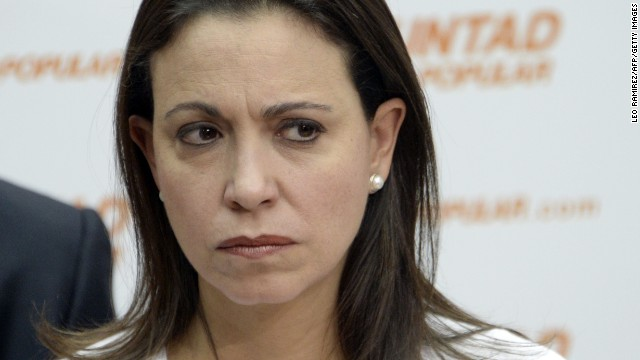 Opposition Leader Maria Corina Machado attends to the press conference in support of the arrested opposition leader Leopoldo Lopez in Caracas on June 05, 2014. Machado will be investigated for alleged involvement in an alleged assassination plan against President Nicolas Maduro, in which was involved the U.S. ambassador to Colombia, said Wednesday the Venezuelan attorney general.