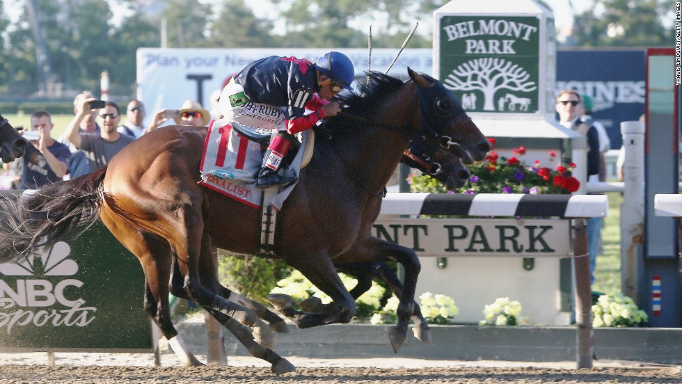 Tonalist, ridden by Joel Rosario, races to the finish line en route to winning the 146th running of the Belmont Stakes at Belmont Park on June 7, 2014, in Elmont, New York.