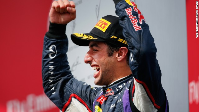 The taste of victory. Daniel Ricciardo celebrates his maiden win after taking the checkered flag in Montreal.