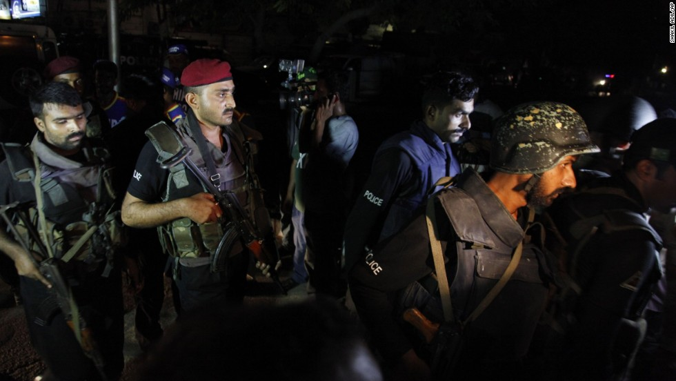 Pakistani commandos get ready to enter an airport terminal on June 8.