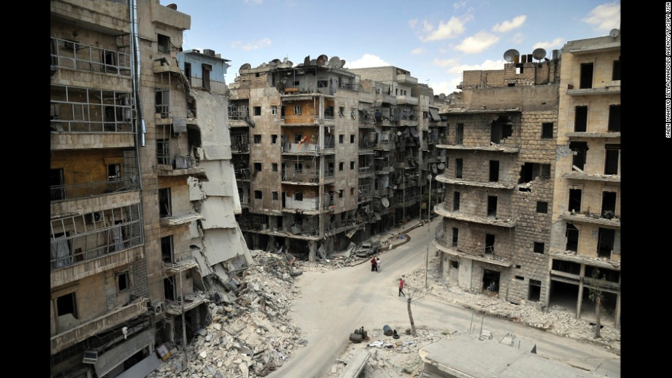 "Apartments and other buildings lie in ruins on Tuesday, June 3, in <a href=""http://www.cnn.com/2014/06/09/world/meast/syria-aleppo-reporters-notebook/"">Aleppo, a city that ""has had the life bombed out of it,""</a> according to CNN's Nick Paton Walsh."