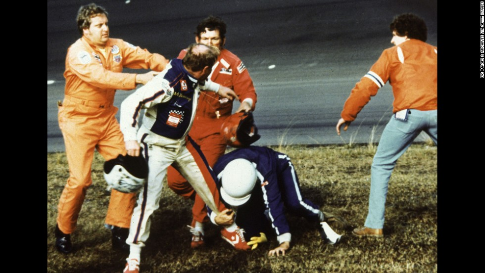 <strong>Cale Yarborough and Donnie Allison: </strong>NASCAR lists it as its top post-race scuffle. After some back-and-forth bumping between Yarborough, second left, and Allison, third left, led the pair to hit the wall and slide into the infield on the final lap of the 1979 Daytona 500, the two exited their cars to argue. When Allison's brother, Bobby, second right, joined the fray, a helmet was swung before a nationally televised brawl broke out.