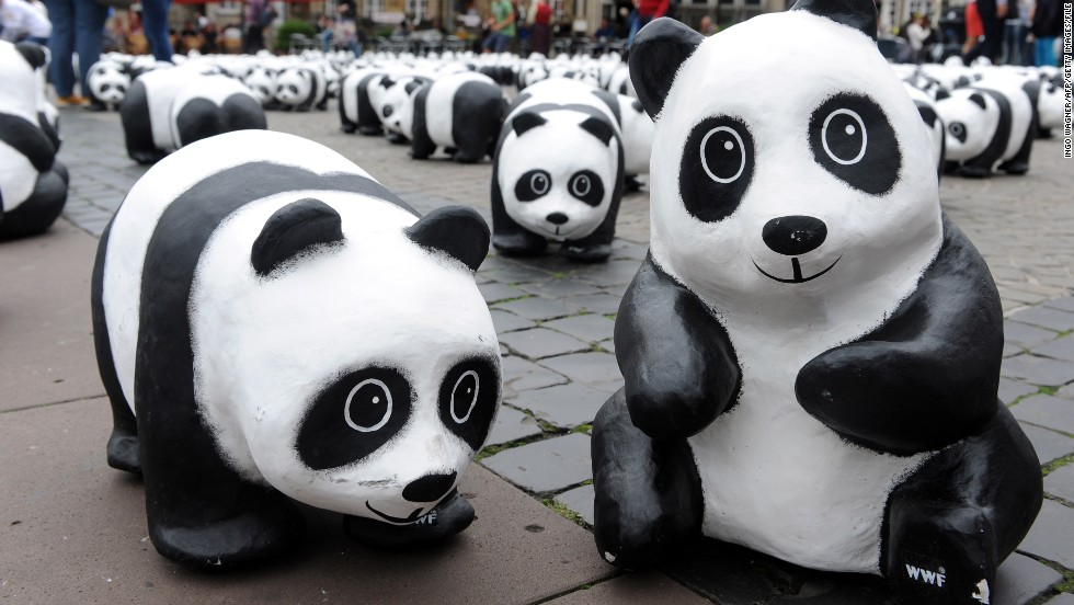 The panda sculptures appear to frolic in a marketplace in Bremen, Germany, in August 2013.