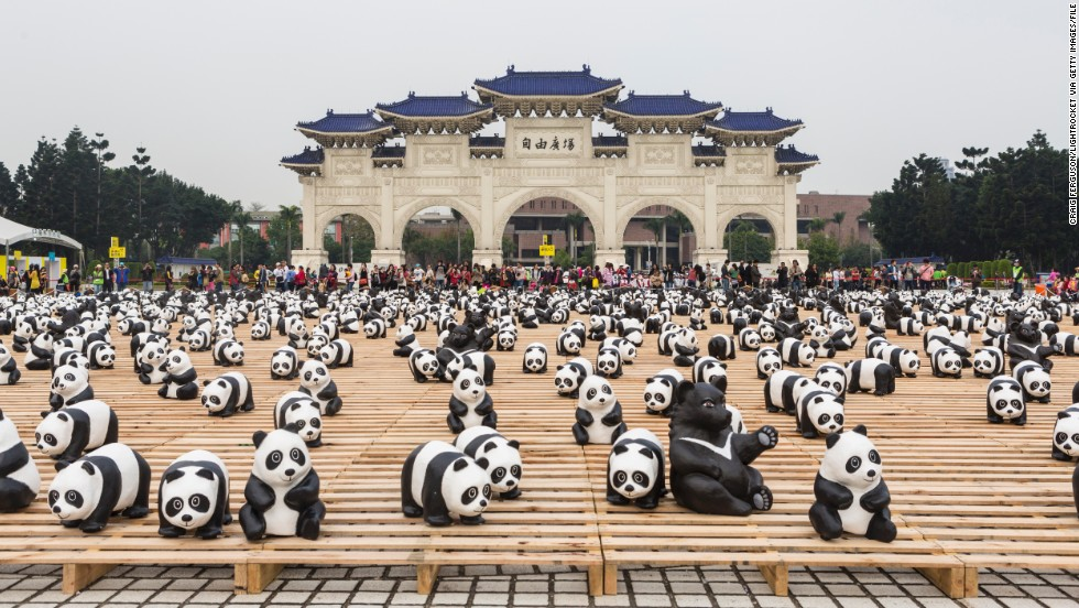 In March, the pandas visit the main gate at the Chiang Kai-shek Memorial Hall in Taipei, Taiwan. Grangeon also created 200 endangered Formosan black bears to join the pandas for the Taipei leg of the tour.