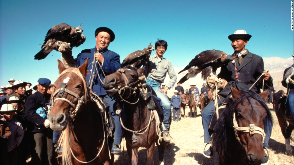 Wong How Man, center, in 1984 with Kirghiz eagle hunters at the border between China's Xinjiang province and the former Soviet Union. A year later, he led an expedition to find the source of the Yangtze River that required him and his team to travel nine days on horseback.