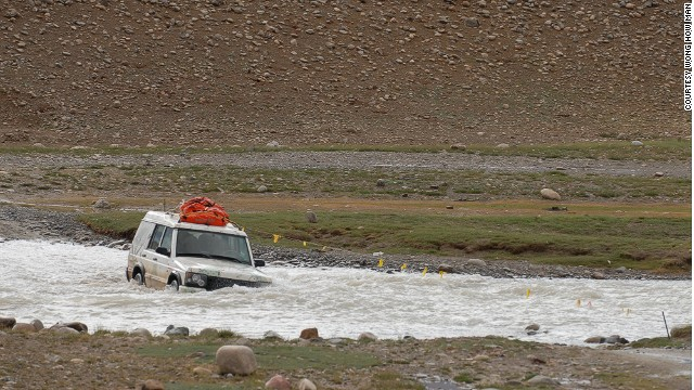 Four-wheel drive river crossing near India's frontier.