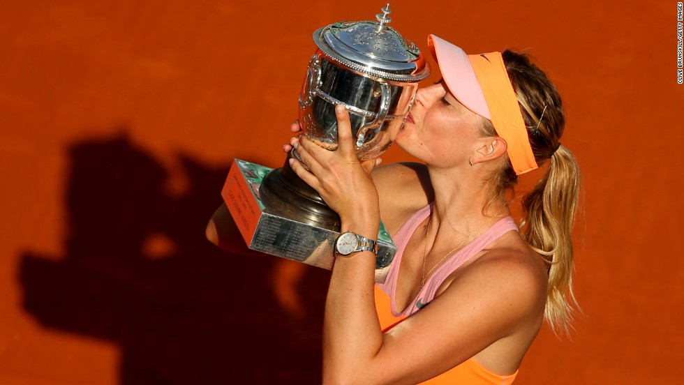 Maria Sharapova kisses the Suzanne Lenglen Trophy after winning the French Open on Saturday, June 7. Sharapova defeated Simona Halep to claim her fifth major tournament and the second French Open title of her career.