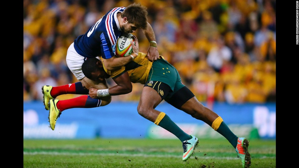 "Australia's Tevita Kuridrani tackles France's Hugo Bonneval during the first match of a three-match rugby series Saturday, June 7, in Brisbane, Australia. Australia won the opener 50-23. <a href=""http://www.cnn.com/2014/06/03/worldsport/gallery/what-a-shot-0603/index.html"">See 39 amazing sports photos from last week</a>"