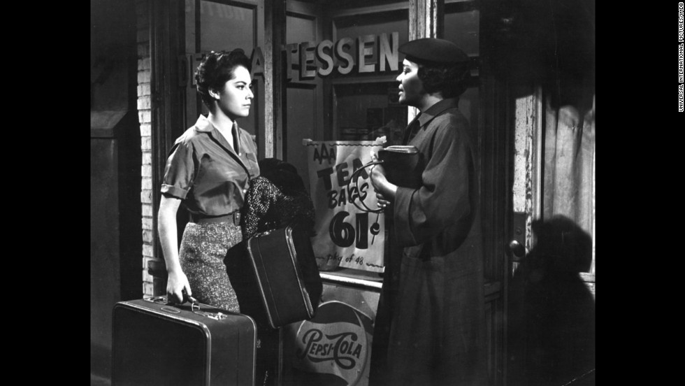 """<strong>""""Imitation of Life"""" (1959)</strong>: This movie, starring Susan Kohner, left and Juanita Moore, is like one long, vicious gut punch. Throughout the movie, we watch as a black housemaid, Annie, is continuously rejected by her fair-skinned daughter, Sarah Jane, who passes for white. We wont' spoil it for you, but when Annie takes ill near the end, that's when the tears really start to flow."""