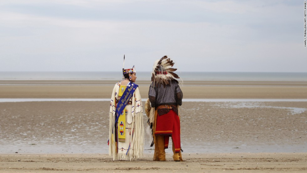 JUNE 10 - SAINTE-MARIE-DU-MONT, FRANCE: Descendants of Comanche Indian soldiers pray on Utah Beach. Seventy years ago, 14 Comanche speakers landed in Normandy with the fourth U.S. infantry division. They used the language to transmit messages that could not be understood by the German occupiers.