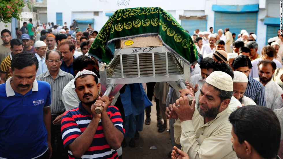 Mourners arrive for funeral prayers on June 10 in Karachi.
