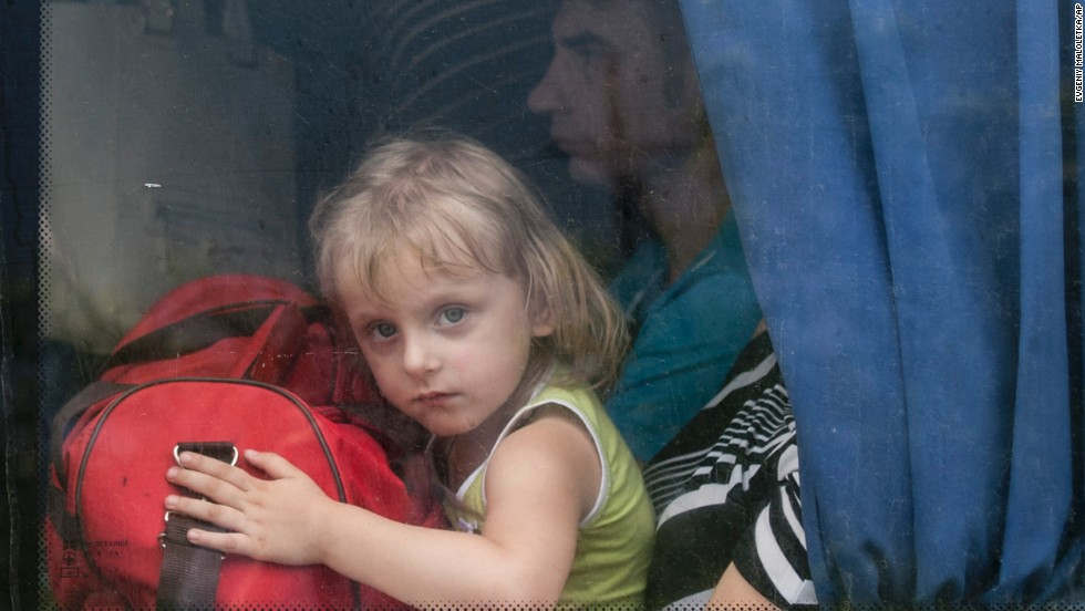 A girl looks out of a bus window as she leaves Slovyansk on Monday, June 9.