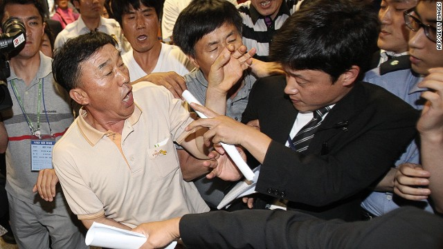 "Family members of passengers onboard the sunken ferry Sewol struggle with a security officer (R) while attempting to attend the murder trial of the captain and crew from the sunken ferry Sewol at the Gwangju District Court in the southwestern South Korean city of Gwangju on June 10, 2014. Captain Lee Joon-Seok and three crew members are accused of ""homicide through wilful negligence"" -- a charge that falls between first-degree murder and manslaughter, but still carries the death penalty. Eleven other members of the crew are being tried on lesser charges of criminal negligence and violations of maritime law. The Sewol was carrying 476 passengers, including 325 students on a school trip, when it sank off the southwest coast on April 16. AFP PHOTO / POOL / Ahn Young-joonAHN YOUNG-JOON/AFP/Getty Images"