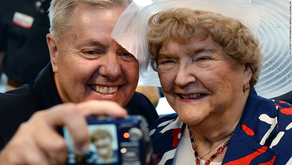 U.S. Sen. Lindsey Graham takes a selfie with MaryAnn Riley following a campaign stop at the YMCA in Spartanburg, South Carolina, on Monday, June 9.