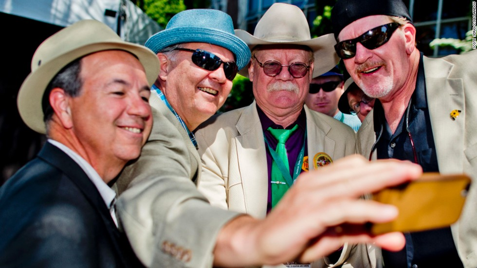 "California Chrome co-owner Steve Coburn, second from right, appears in a photo with fans Saturday, June 7, at Belmont Park in Elmont, New York. Coburn's horse <a href=""http://www.cnn.com/2014/06/07/us/gallery/belmont-stakes-2014/index.html"">came up short</a> in its quest to win the Triple Crown, finishing fourth in the Belmont Stakes."
