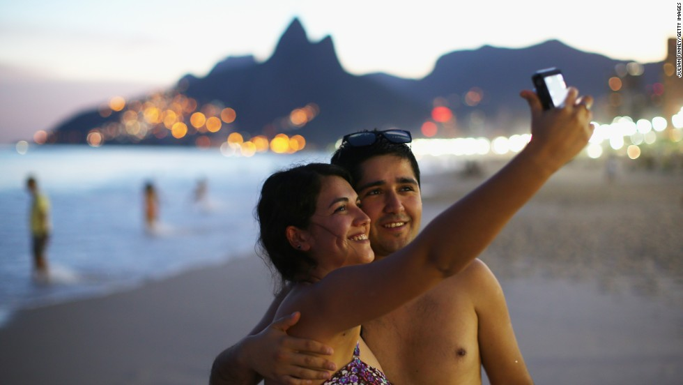 A couple snaps a selfie Sunday, June 8, on Ipanema Beach in Rio de Janeiro. Rio is one of the 12 Brazilian cities that will be hosting World Cup soccer games this month.