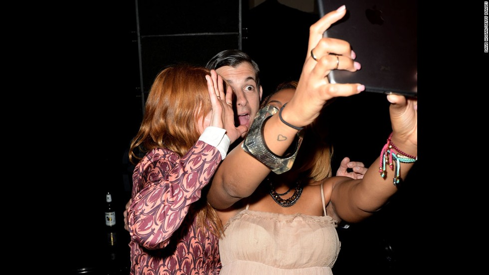 Singer Florence Welch, left, and musician Mark Ronson appear in a selfie Wednesday, June 4, as they attend The Other Ball in London for the charity Arms Around the Child.