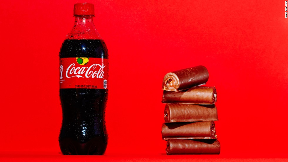 <strong>Soda: Coca-Cola.</strong><br />A 20-ounce bottle of Coca-Cola Classic contains 65 grams of sugar, which is the same amount of sugar found in five Little Debbie Swiss Rolls.