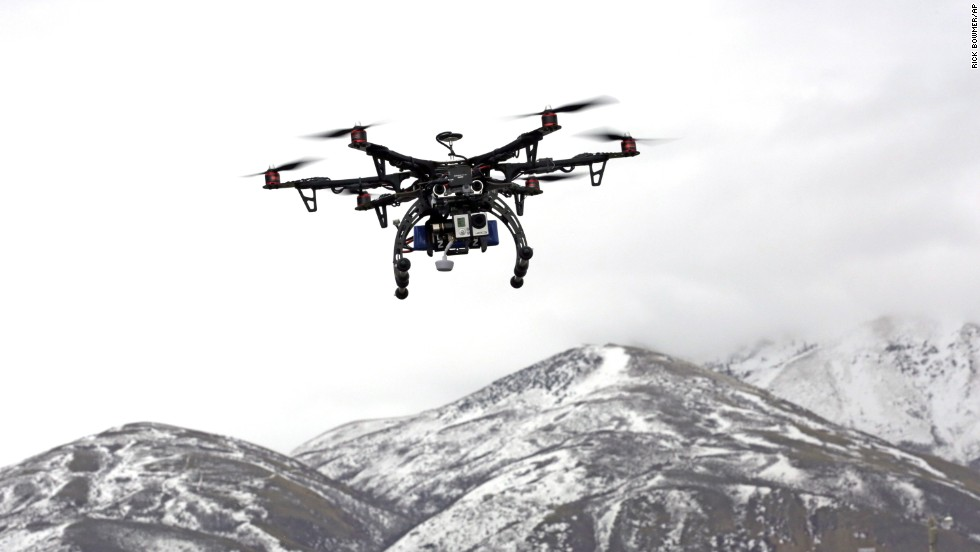 Members of the Box Elder County Sheriff's Office fly their search-and-rescue drone during a demonstration in Brigham City, Utah, on February 13, 2014. Gov. Gary Hebert has approved the state's first drone restrictions, setting new limits on law enforcement's use of the technology.